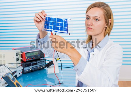 The technician is testing film solar cells - stock photo