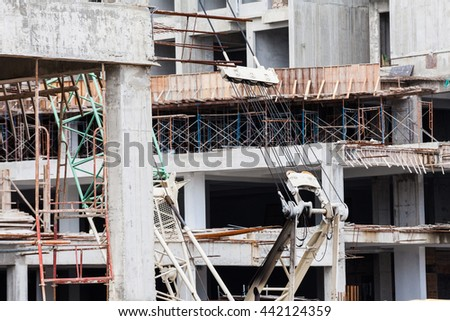 The technology or art of high rise apartment construction using crane, lift, metal beam, brick, metal ladder and concrete.