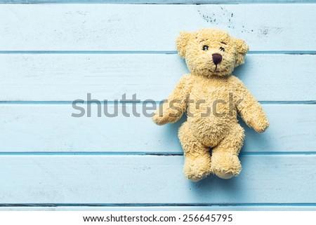 the teddy bear on blue table - stock photo