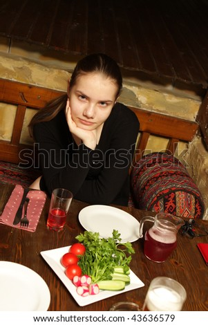 The teen in a restaurant waiting main dish
