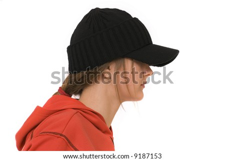 The teenage girl is dressing with black cap.