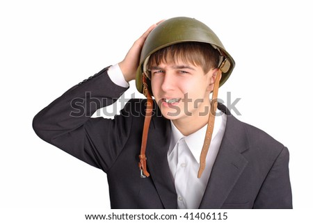 The teenager in a military helmet - stock photo