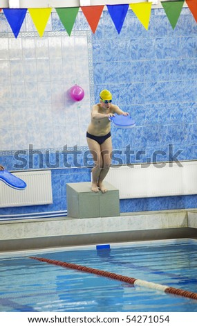 The teenager jumps from a curbstone in pool - stock photo
