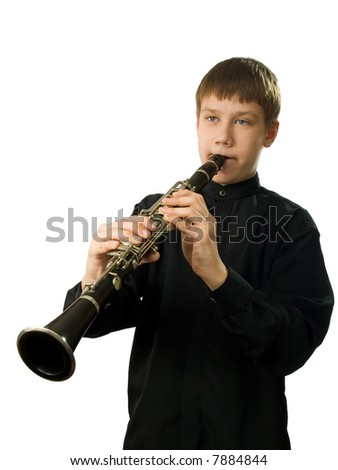 The teenager playing on a clarnet. It is isolated on a white background. - stock photo