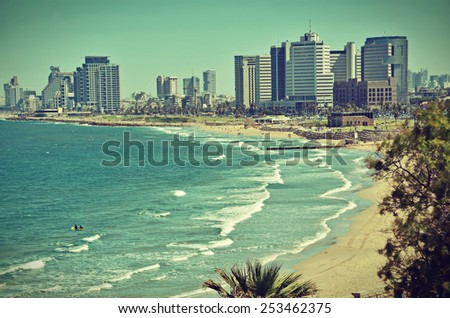 The Tel Aviv, Israel sky line and the Mediterranean beach from Jaffa - old postcard / vintage look - stock photo