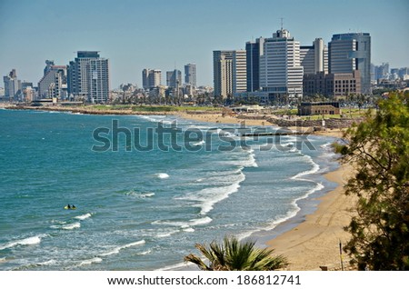 The Tel Aviv, Israel sky line and the Mediterranean beach from Jaffa on a late spring / early summer day - stock photo