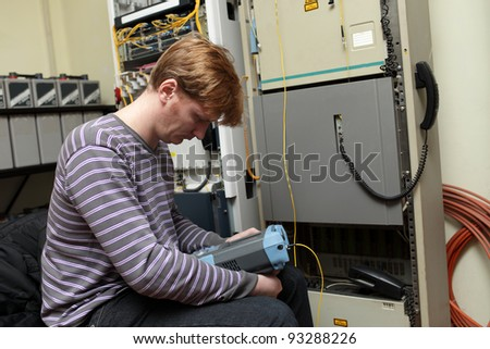 The telecom technician working at server room - stock photo