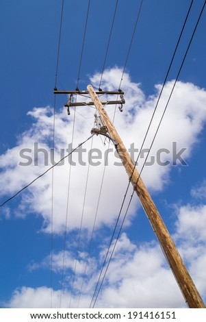 The telephone pole in the Southern California sun. - stock photo