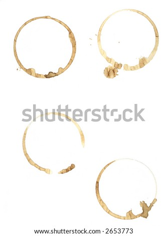 The tell tale signs of a morning caffeine fix spattered on plain file paper. - stock photo