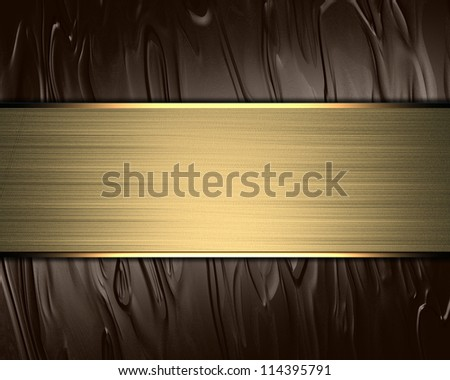 The template for the inscription. Brown background with a gold nameplate for writing. - stock photo