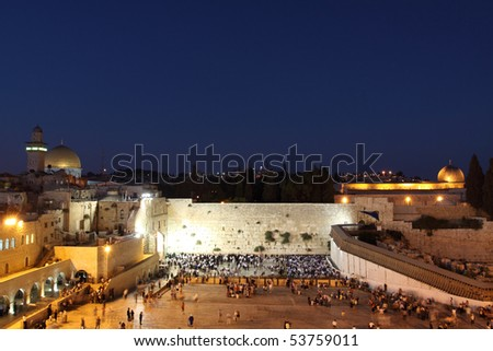 The Temple Mount in Jerusalem, including the Western Wall and the golden Dome of the Rock at Night - stock photo