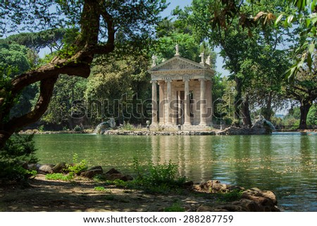 The Temple of Esculapio is one of the many ancient building that a tourist can find in the beautiful park of Villa Borghese in Rome - stock photo