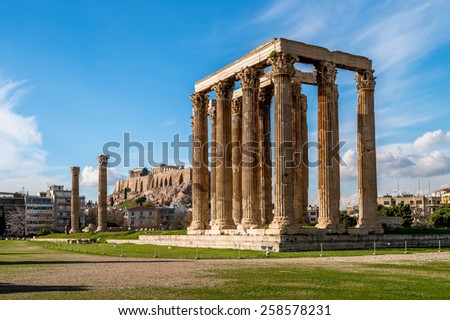 The Temple of Olympian Zeus with the hill of the Acropolis in the background - Athens, Greece - stock photo