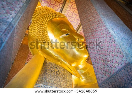The Temple of reclining buddha (gold statue) in Wat Pho, Bangkok, Thailand, Asia. - stock photo