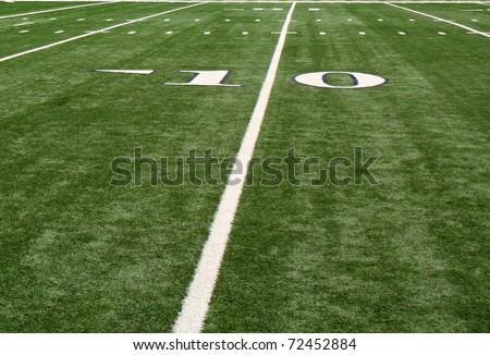 The ten (10) yard line on a football field. - stock photo