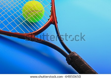 The tennis ball and racket