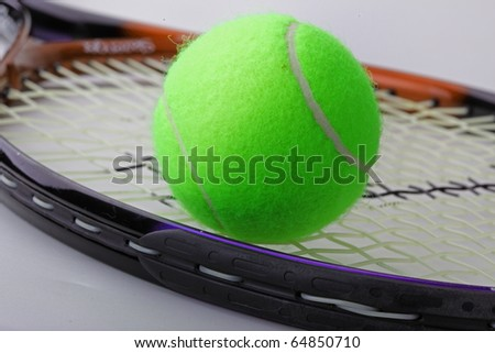 The tennis ball and racket - stock photo