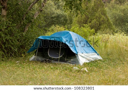 the tent in nature - stock photo