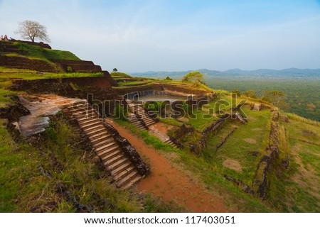 The terraced ruins at the summit top of Sigiriya rock, a former fortress, palace and monastery in Sri Lanka - stock photo