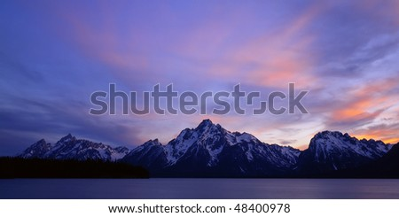 The Teton Mountain Range and Jackson Lake in Grand Teton National Park, Wyoming. - stock photo