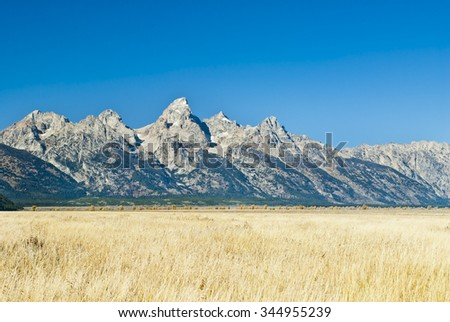 The Teton Peaks and grassy sagebrush steppe of Wyoming near Jackson Hole in Autumn.