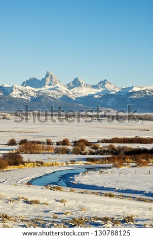 The Teton Peaks, Mountains, and Teton Valley in Idaho, blanketed in winter. - stock photo
