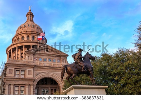 The Texas Capitol Building/ Texas Capitol and Ranger Statue/ The Texas Ranger statue in front of the Texas Capital building in Austin, TX - stock photo