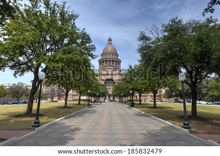 The Texas State Capitol Building in downtown Austin. The building was built in 1882-1888 of distinctive sunset red granite. - stock photo