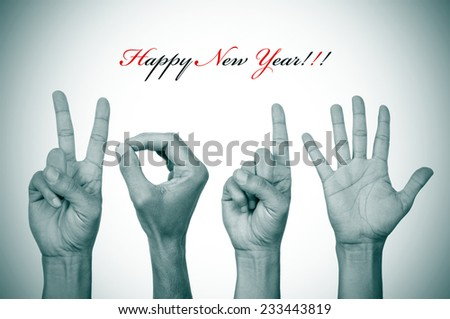 the text happy new year and man hands in black and white forming the number 2015 - stock photo