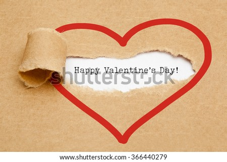 The text Happy Valentines Day appearing behind torn brown paper.  - stock photo