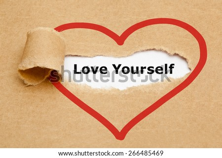 The text Love Yourself appearing behind torn brown paper. - stock photo