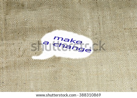 The text MAKE A CHANGE behind torn brown burlap