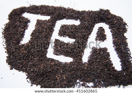 The text of the tea leaves of black tea on a white background