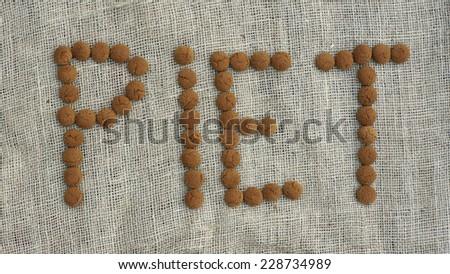 The text Piet is written with pepernoten, typical Dutch treat for Sinterklaas on 5 december - stock photo