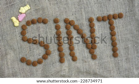 The text Sint is written with pepernoten, typical Dutch treat for Sinterklaas on 5 december - stock photo