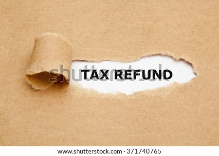 The text Tax Refund appearing behind torn brown paper.  - stock photo