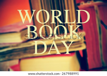 the text world book day with a pile of blurred old books in the background - stock photo