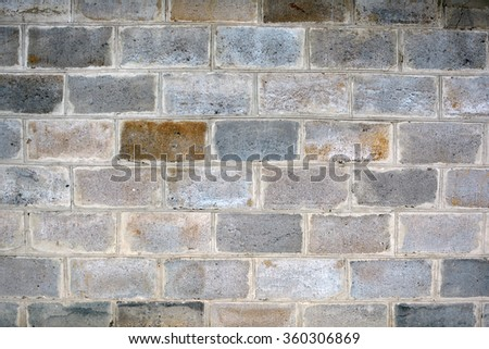 The texture of a brick wall. Clay bricks. Stone wall. Background. The texture of the stone wall. Stone in the section. Limestone. Granite. Marble. Coquina. Background. Stone floor. Pebbles. Macadam. - stock photo