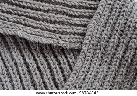 The texture of a knitted woolen fabric. Background