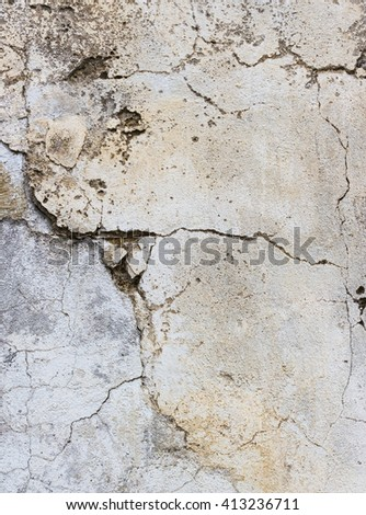 The texture of a wall with cracked plaster