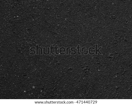 The texture of old wet asphalt