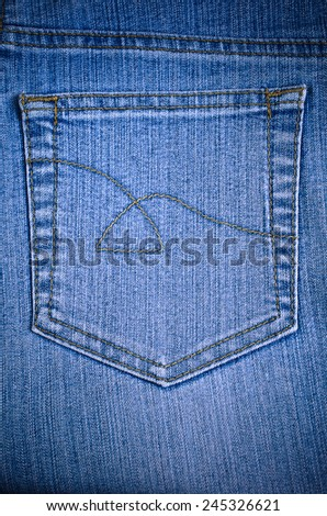 The texture of pure blue denim with pocket. - stock photo