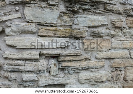 The texture of the ancient wall made of rock - stock photo