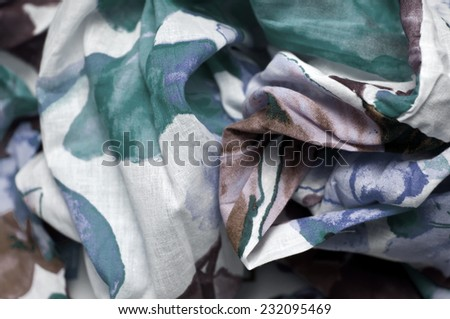 The texture of the cotton flower fabric with folds