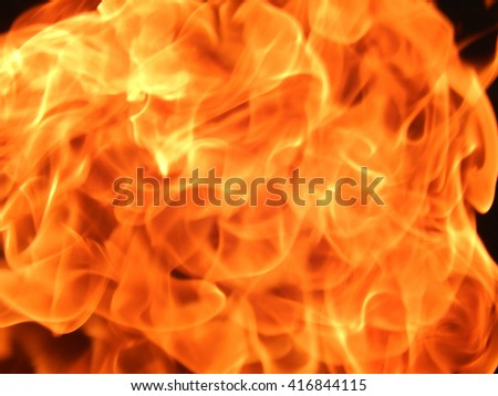 The texture of the flames on a black background - stock photo