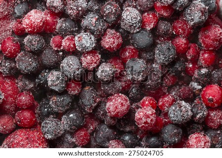 The texture of the frozen berries closeup - stock photo