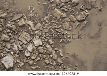 The texture of the mud or wet soil along a country road after rain - stock photo