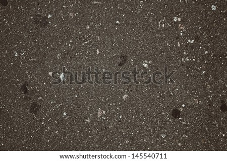 The texture of the old gray dirty asphalt macro - stock photo