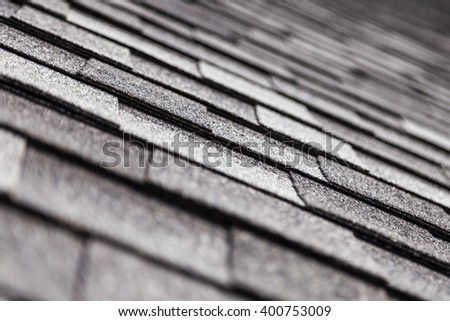 The texture of the roof tiles shingles. Construction material. Perspective view. Close-up view with blurred background. - stock photo