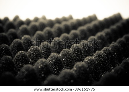The texture of the sponge with embossed surface for background. Selective focus. Shallow depth of field. Toned. - stock photo